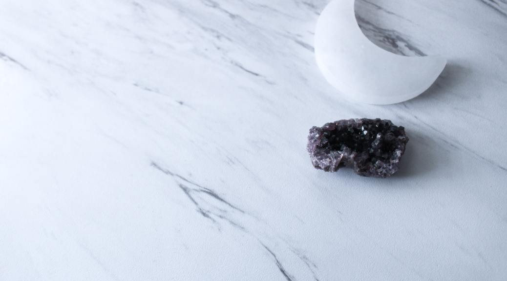 moon and crystal on marble background