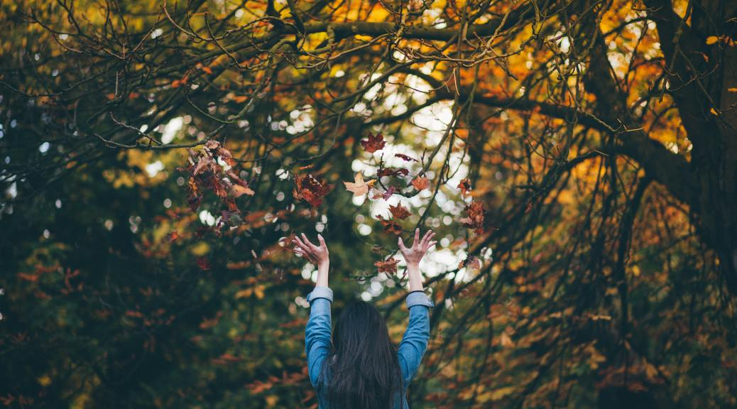 Girl reaching for the trees